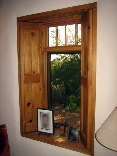 New window frame detail showing reused/repurposed ca. 1900 shiplap lumber salvaged from old Taos Inn outbuildings