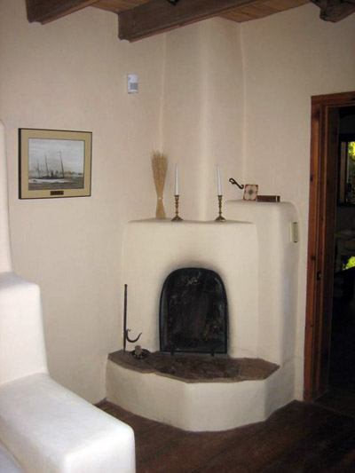 One of several new kiva fireplaces added to various rooms; traditional style with unique hearthstone